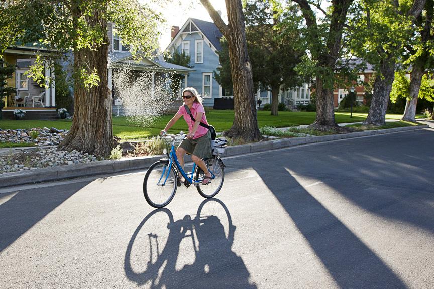 Lisa pedaling on 5th Street, Salida